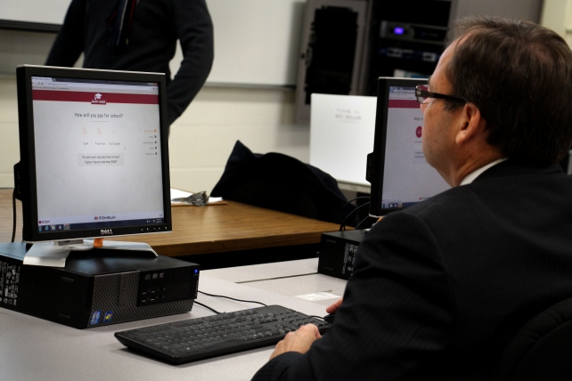 A photo of Mohawk President Ron McKerlie using the Reality Cheque tool.