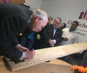Dr. Douglas Barber and his wife June have donated $100,000 in support of City School by Mohawk. Everyone at Friday's opening signed a ceremonial ruler made from a 100-year-old church pew. The ruler, like the classroom, was refurbished by our Building Renovation faculty and students.